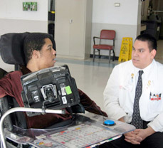 medical student learns how to communicate with non-verbal adult with developmental disability